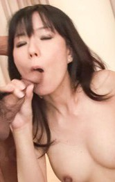 Manami Komukai Asian gets vibrator on chest and sucks two tools