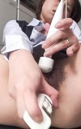 Kaoru Natsuki Asian puts vibrator on clit and dildo in hairy slit